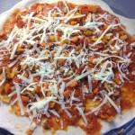 uncooked chorizo pizza