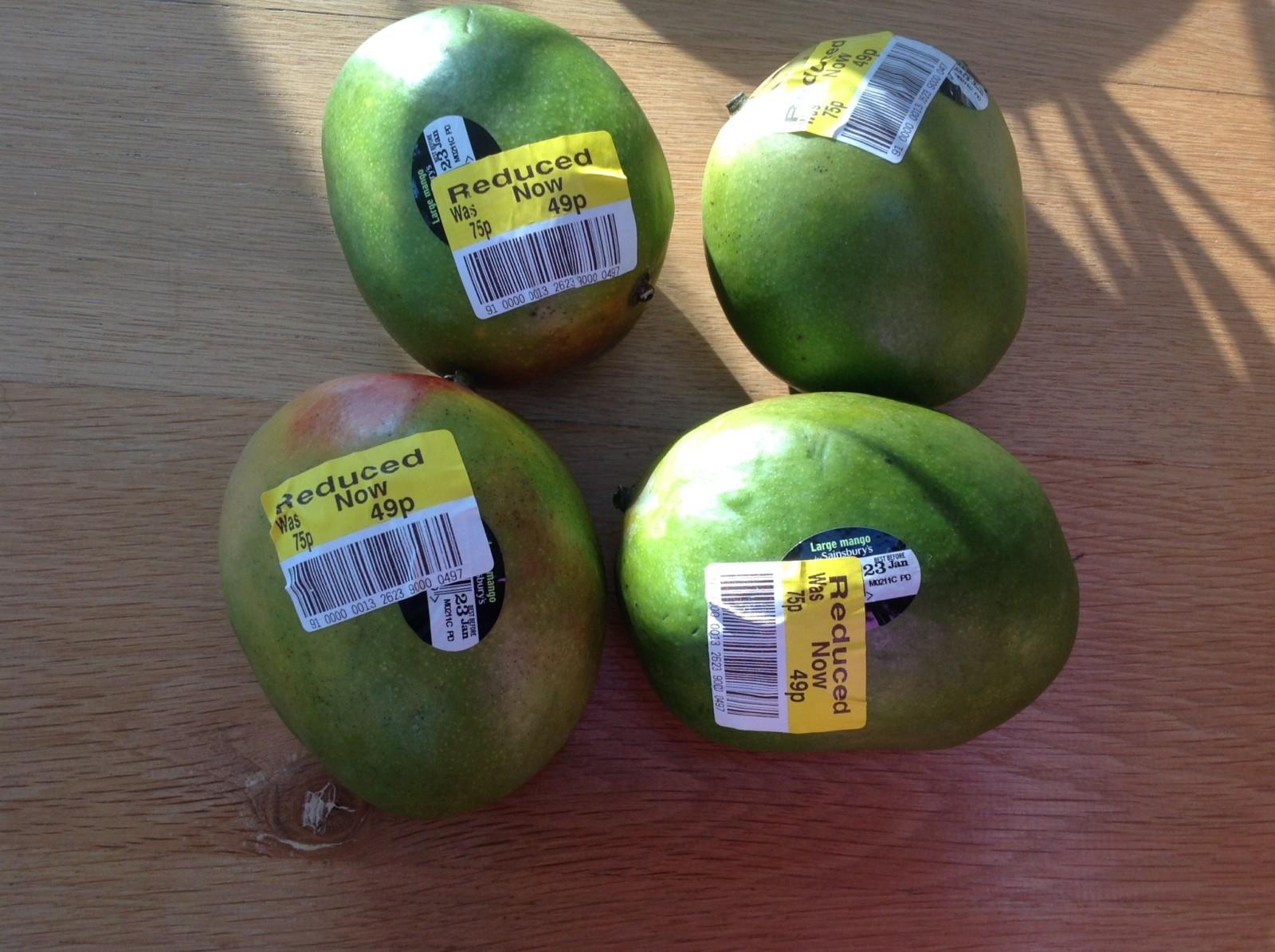 Yellow sticker mangoes